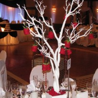 White branch centrepiece with Hanging Roses
